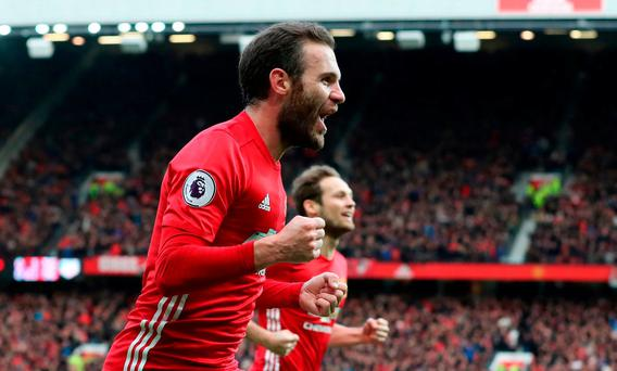 Manchester United's Juan Mata celebrates scoring his side's first goal