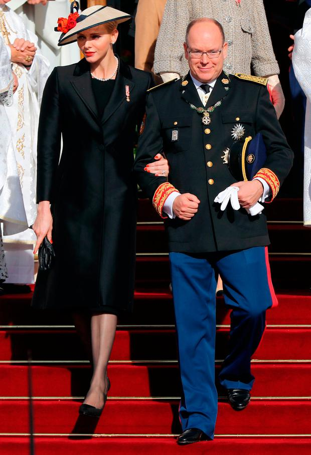 Prince Albert II of Monaco (R) and princess Charlene of Moanco (L) leave the cathedral after a mass during the celebrations marking Monaco's National Day
