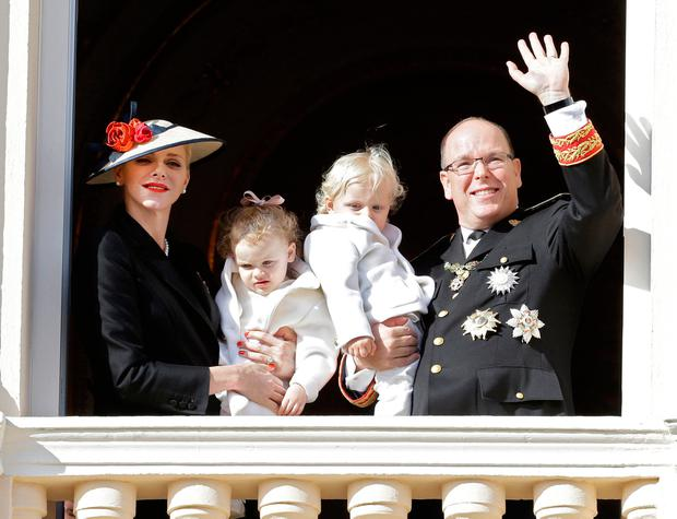 Prince Albert II of Monaco, right, with his wife Princess Charlene and their twins, Prince Jacques, right, and Princess Gabriella, attend from the Monaco palace to the Monaco's national day ceremony, in Monaco, Friday Nov. 19, 2016. Monaco's Fete Nationale has been celebrated since the reign of Prince Charles III in 1857. (AP Photo/Claude Paris)