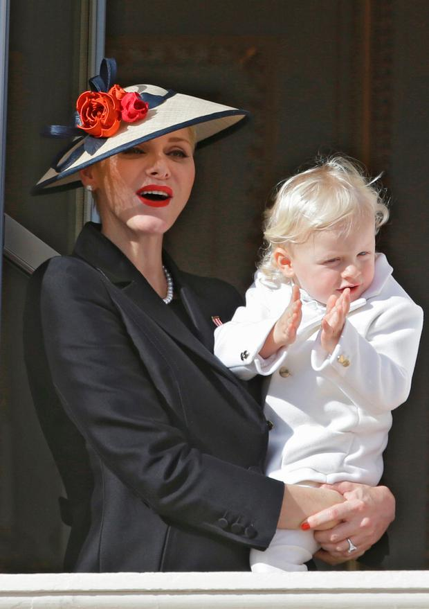 Princess Charlene, Prince Albert II of Monaco's wife, and their son Prince Jacques, attend from the Monaco palace to the Monaco's national day ceremony, in Monaco, Friday Nov. 19, 2016. Monaco's Fete Nationale has been celebrated since the reign of Prince Charles III in 1857. (AP Photo/Claude Paris)