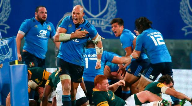 Italy's Sergio Parisse celebrates a try scored by teammate Giovanbattista Venditti against South Africa. REUTERS/Alessandro Bianchi
