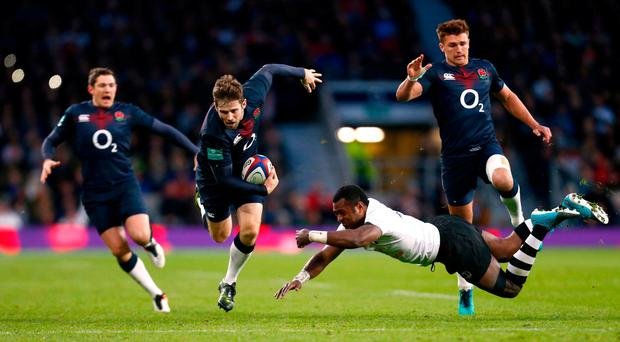 Fiji's Kini Murimurivalu in action with England's Elliot Daly. Reuters