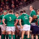The Ireland team gather in a huddle after conceding the first try