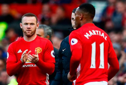 Manchester United's Wayne Rooney comes on as a substitute to replace Anthony Martial