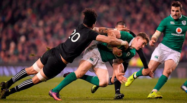 Garry Ringrose of Ireland in action against Ardie Savea of New Zealand during the Autumn International match between Ireland and New Zealand at the Aviva Stadium in Dublin.