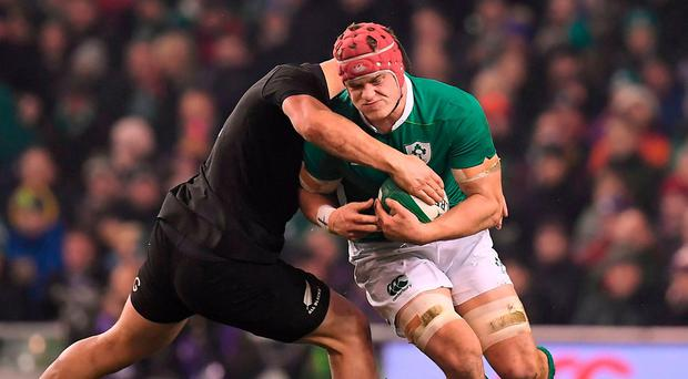 Josh van der Flier of Ireland is tackled by Dane Coles of New Zealand defence during the Autumn International match between Ireland and New Zealand at the Aviva Stadium in Dublin. Photo by Brendan Moran/Sportsfile