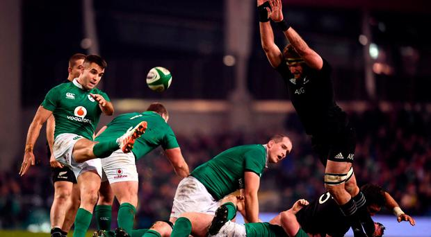 Conor Murray of Ireland kicks clear despite the attention of Kieran Read of New Zealand during the Autumn International match between Ireland and New Zealand at the Aviva Stadium, Lansdowne Road, in Dublin. Photo by Stephen McCarthy/Sportsfile