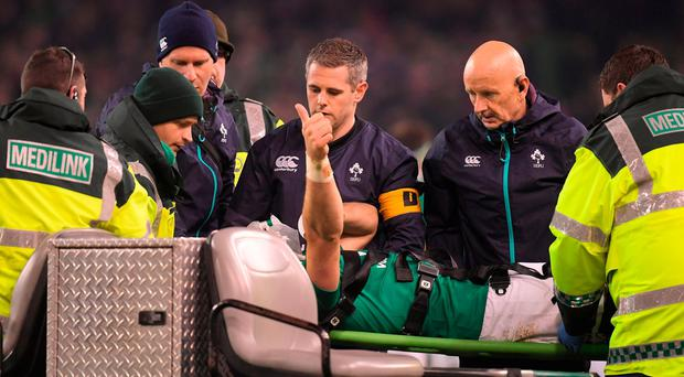 Robbie Henshaw of Ireland signals to the crowd as he is taken from the field on a stretcher during the Autumn International match between Ireland and New Zealand at the Aviva Stadium in Dublin. Photo by Brendan Moran/Sportsfile