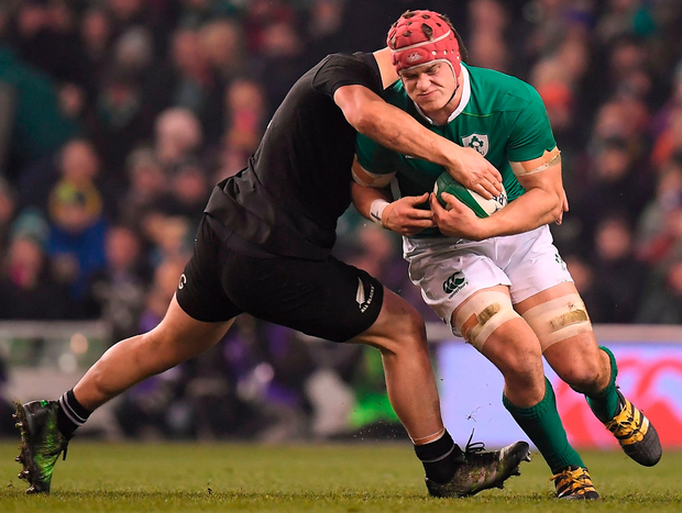 Josh van der Flier is tackled by Dane Coles during the Autumn International match at the Aviva Stadium yesterday. Photo: Sportsfile