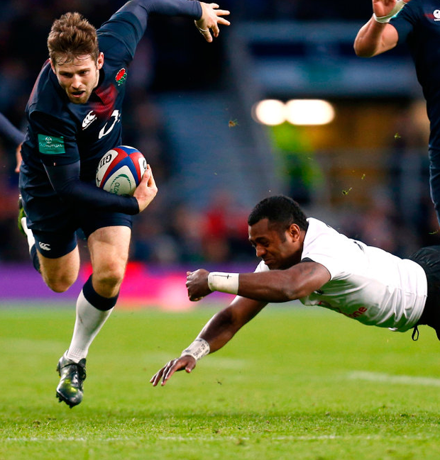 Fiji's Kini Murimurivalu in action with England's Elliot Daly during the Autumn International match at Twickenham yesterday. Photo: Reuters