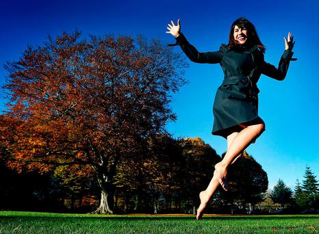 HAPPY FEET — WALKING BACK TO HAPPINESS: Victoria Mary Clarke braves the cold Irish weather and strolls barefoot in scenic Herbert Park, Dublin. Photo: Steve Humphreys