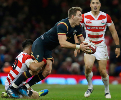 Yu Tamura tackles Wales' full back Liam Williams during the International match between Wales and Japan at the Principality Stadium yesterday. Photo: Getty Images