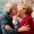STRATEGY: German Chancellor Angela Merkel greets British PM Theresa May in Berlin last Friday. Photo: Sean Gallup/Getty Images