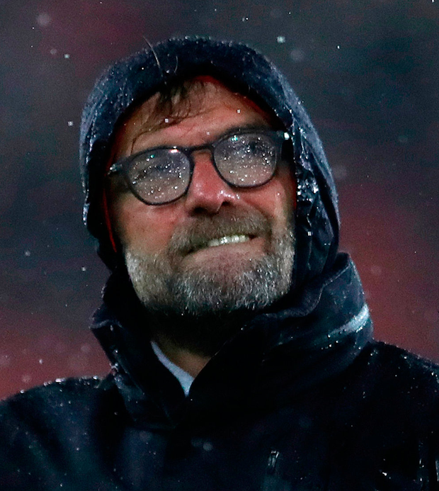 A soaked Liverpool manager Jurgen Klopp reacts after the final whistle during the match at St Mary's Stadium, Southampton. Photo: Nick Potts/PA