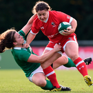 Carolyn McEwen of Canada is tackled by Ireland's Zoe Grattage at Belfield. Photo: Sportsfile