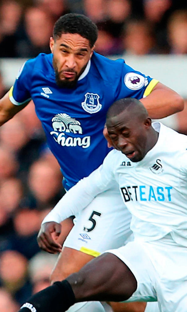 Everton's Ashley Williams (left) and Swansea City's Modou Barrow (right) battle for the ball in the air during the Premier League match at Goodison Park. Photo: Peter Byrne/PA