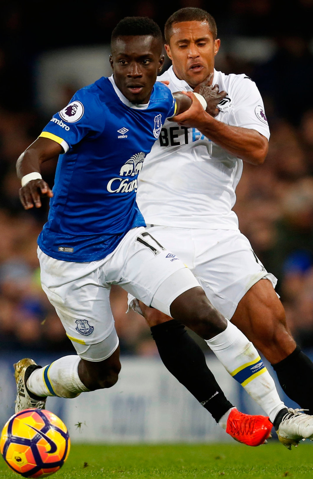 Everton's Idrissa Gueye battles with Swansea City's Wayne Routledge. Photo: Ed Sykes/Reuters