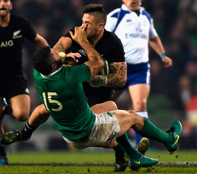 Rob Kearney and New Zealand's TJ Perenara clash into each other in what was a bruising encounter