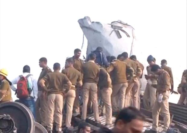 Police officers and people gather at the site where a train derailed in Kanpur, in India's northern state of Uttar Pradesh, in this still image taken from video November 20, 2016. ANI/via REUTERS