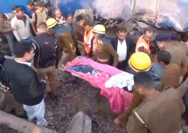 Rescuers move a body at the site where a train derailed in Kanpur, in India's northern state of Uttar Pradesh, in this still image taken from video November 20, 2016. ANI/via REUTERS TV