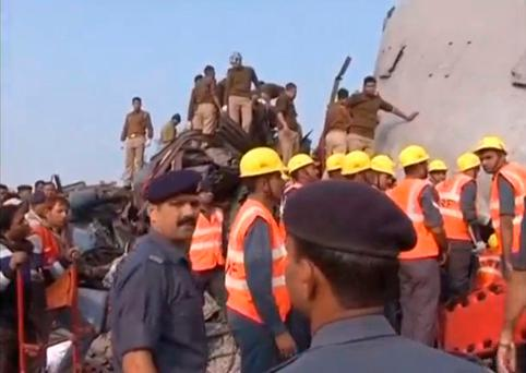 Rescuers and people gather at the site where a train derailed in Kanpur, in India's northern state of Uttar Pradesh, in this still image taken from video November 20, 2016. ANI/via REUTERS