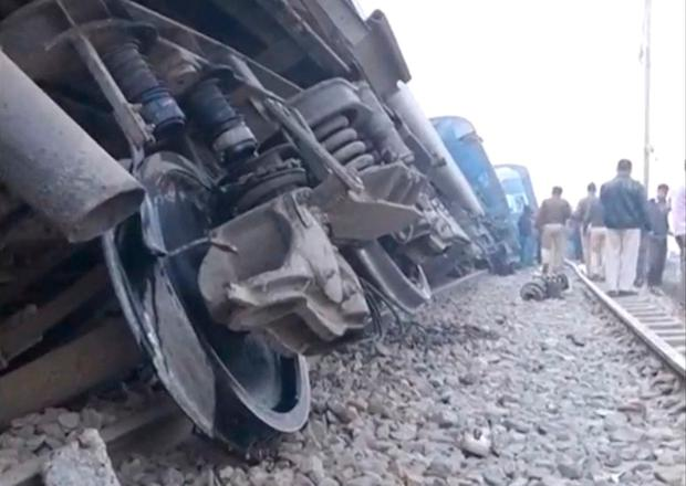 People gather next to a derailed train in Kanpur, in India's northern state of Uttar Pradesh, in this still image taken from video November 20, 2016. ANI/via REUTERS