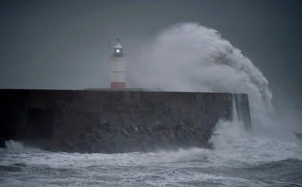 Waves crash against the harbour wall as Storm Angus passes Newhaven in southern Britain, November 20, 2016. REUTERS/Hannah McKay