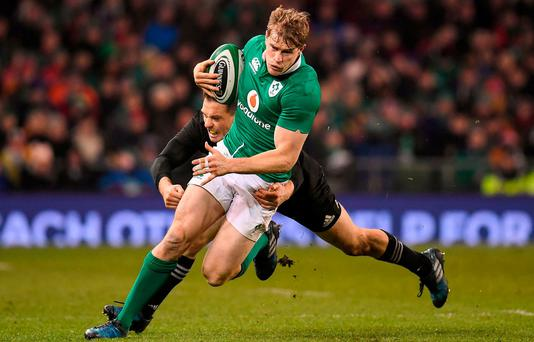 Andrew Trimble of Ireland is tackled by Ben Smith of New Zealand during the Autumn International match between Ireland and New Zealand at the Aviva Stadium in Dublin. Photo by Brendan Moran/Sportsfile