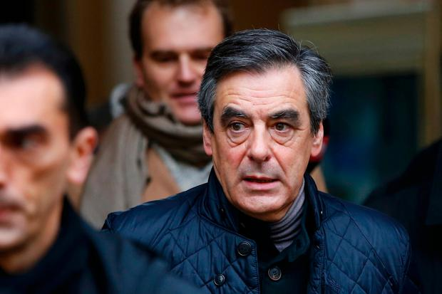 French politician Francois Fillon, member of the conservative Les Republicains political party, leaves the polling station after he voted in the first round of the French center-right presidential primary election in Paris, France, November 20, 2016. REUTERS/Gonzalo Fuentes