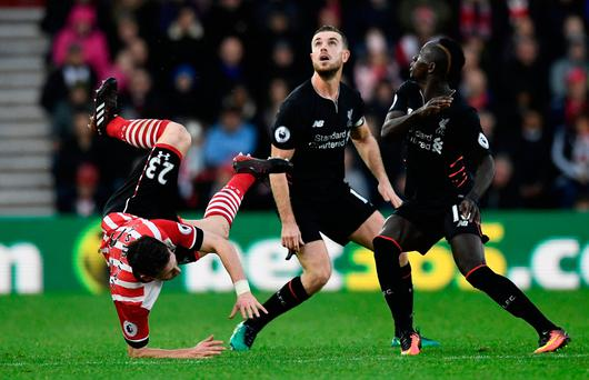 Liverpool's Jordan Henderson and Sadio Mane in action with Southampton's Pierre-Emile Hojbjerg