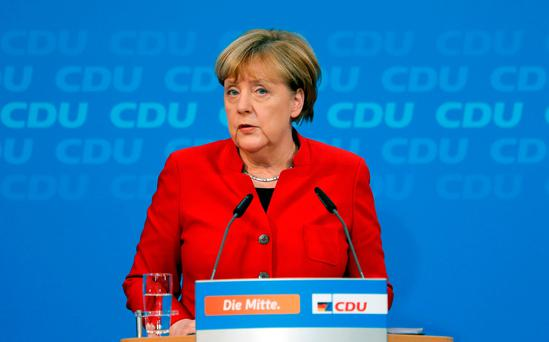 German Chancellor Angela Merkel addresses a news conference, to announce that she will run again for the Chancellorship in the next year general elections