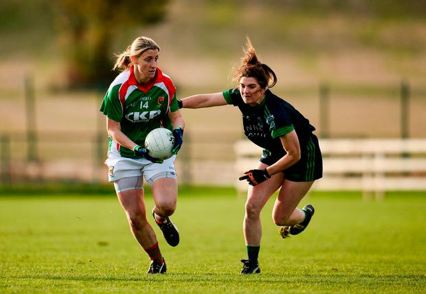 Cora Staunton of Carnacon in action Niamh Collins of Foxrock Cabinteely. Photo by Sam Barnes/Sportsfile