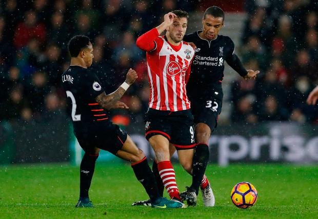 Southampton's Jay Rodriguez in action with Liverpool's Joel Matip and Nathaniel Clyne. Photo: Reuters / Matthew Childs