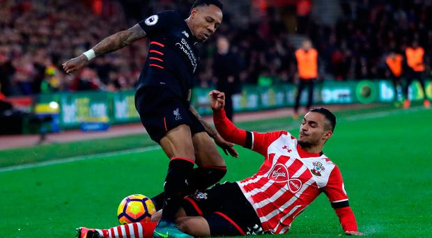 Liverpool's Nathaniel Clyne (left) is challenged by Southampton's Sofiane Boufal. Photo credit: Nick Potts/PA Wire