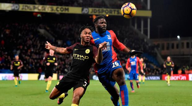 Manchester City's Raheem Sterling in action with Crystal Palace's Bakary Sako. Photo: Reuters / Hannah McKay