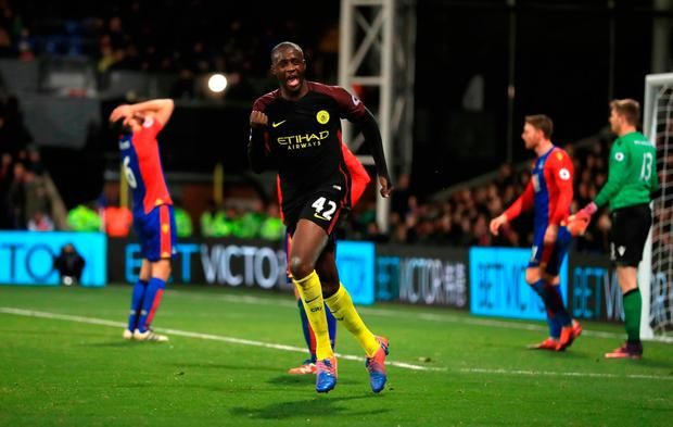 Manchester City's Yaya Toure celebrates scoring his side's second goal of the game. Photo credit: John Walton/PA Wire
