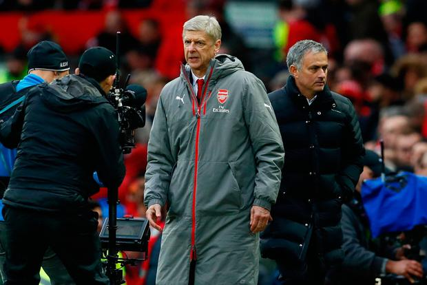Arsene Wenger and Joe Mourinho look the other way at Old Trafford. Photo: Reuters / Jason Cairnduff