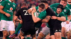Ireland's Garry Ringrose, supported by Conor Murray (left) and Sean O'Brien (right), is tackled by Aaron Cruden (left) and Codie Taylor of New Zealand on Saturday. Photo by Brendan Moran/Sportsfile