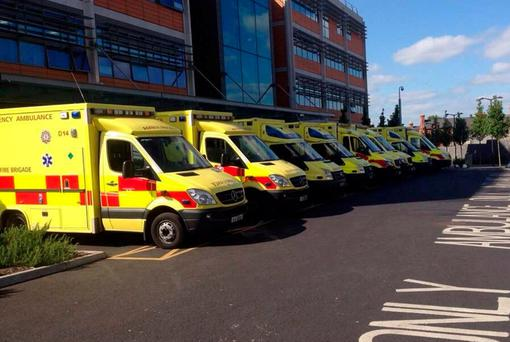 Eight ambulances wait at the Mater for the return of trolleys