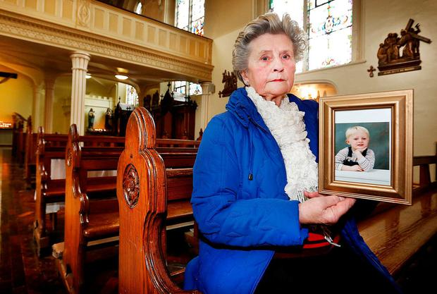 Carmel Ridgeway, Drumcondra, holds a photograph of her grandson Ross Redmond who died in an accident 16 years ago. Photo: Steve Humphreys