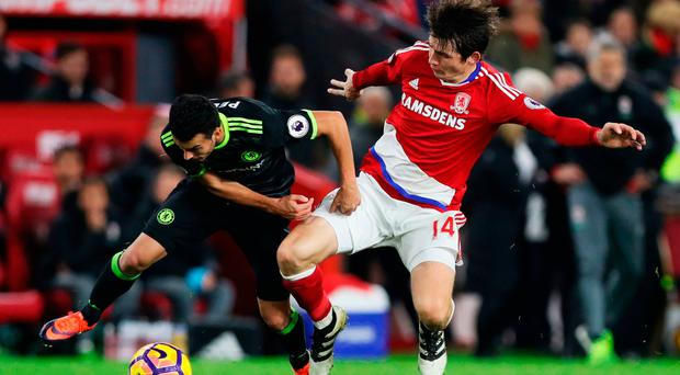 Marten de Roon of Middlesbrough tackles Pedro of Chelsea. Photo by Ian MacNicol/Getty Images