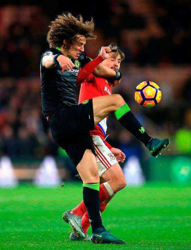 David Luiz of Chelsea challenges Gaston Ramirez of Middlesbrough. Photo by Jan Kruger/Getty Images