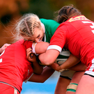Ciara Cooney is tackled by Laura Russell and Daleaka Menin of Canada. Photo by Matt Browne/Sportsfile