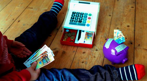 Almost 60pc said that the best way of teaching children about budgeting was to open a savings account for them and encourage them to save money. Photo: Brian Lawless/PA Wire