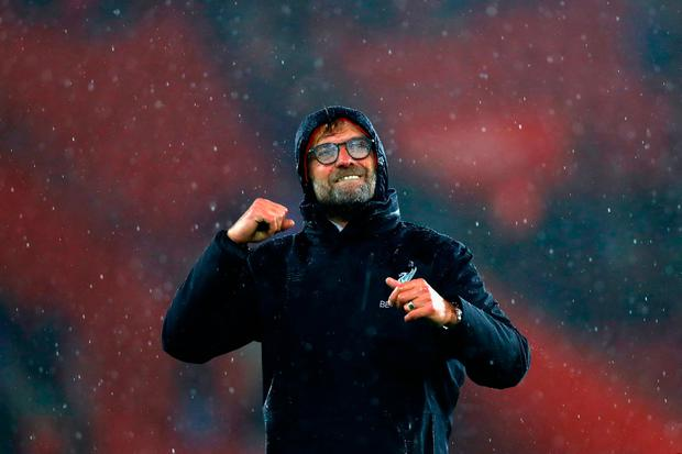 Jurgen Klopp shows his appreciation of Liverpool's efforts. Photo by Clive Rose/Getty Images