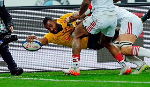 Australia's Tevita Kuridrani (L) scores a try during his match against France. Photo: Reuters
