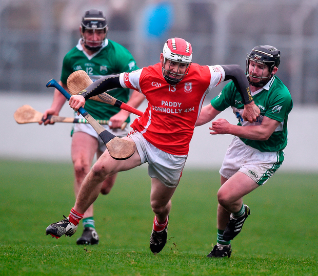 Cuala's Con O'Callaghan in action against Garry Bennett of St. Mullins. Photo: David Maher/Sportsfile