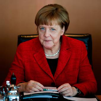 Her generous response to Europe's refugee crisis, at some cost to her own popularity, is in marked contrast with the threshing Mr Trump gave the world's dispossessed and disadvantaged. Picture: AP Photo/Markus Schreiber