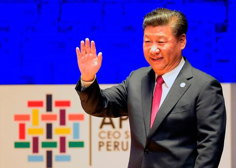 China's President Xi Jinping waves as he prepares to speak during a session of the APEC CEO Summit. Photo: Getty