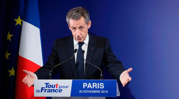 Nicolas Sarkozy, former French president and candidate for the French conservative presidential primary, reacts after partial results in the first round of the French center-right presidential primary election at his campaign headquarters in Paris, France, November 20, 2016. REUTERS/Ian Langsdon/Pool